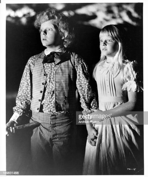 Johnny Whitaker and Jodie Foster with stunned looks in a scene from the film 'Tom Sawyer' 1973