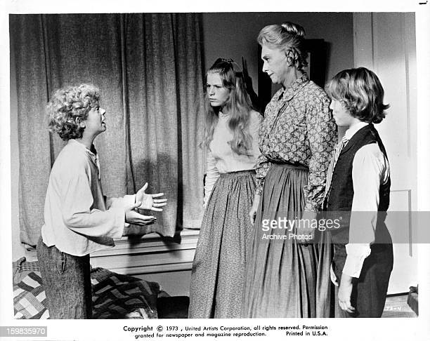 Johnny Whitaker pleads with Celeste Holm in a scene from the film 'Tom Sawyer' 1973