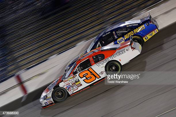 Johnny White driver of the MMI Services Chevrolet races Nick Drake driver of the NAPA Auto Parts Toyota during the NASCAR KN Pro Series Casey's...