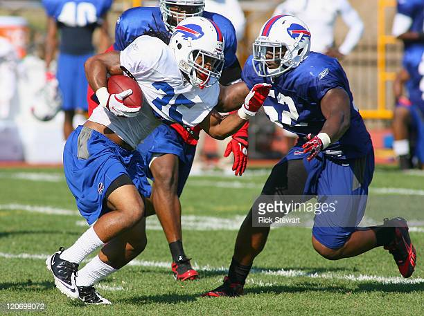 Johnny White of the Buffalo Bills runs against Arthur Moats during the Buffalo Bills Training Camp at St John Fisher College on August 8 2011 in...