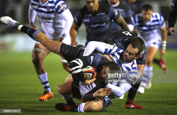 Johnny Williams of Newcastle is tackled by Jack Wilson of Bath Rugby during the Premiership Rugby Cup match between Newcastle Falcons and Bath Rugby...