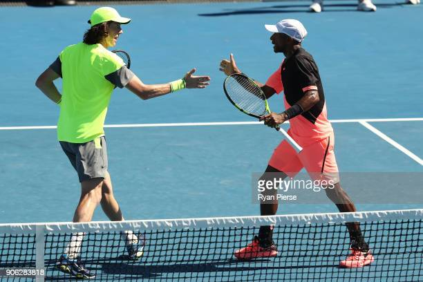JohnPatrick Smith of Australia and Nicholas Monroe of the United States compete in their first round men's doubles match against Nick Kyrgios of...