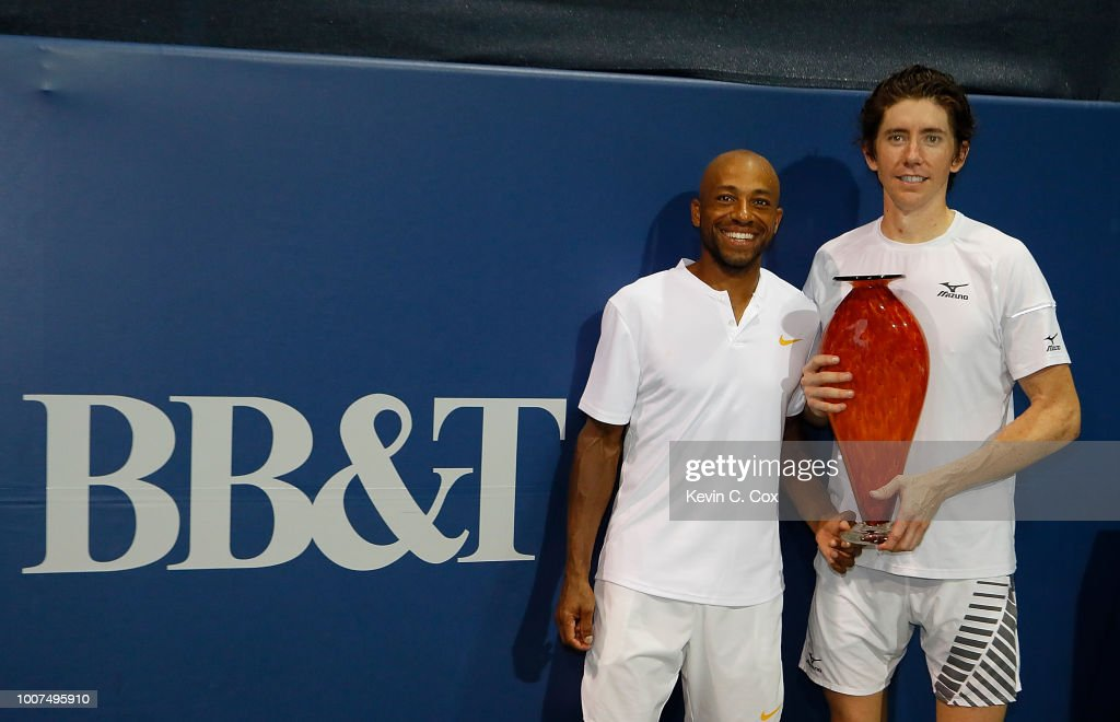 John-Patrick Smith of Australia and Nicholas Monroe pose with the trophy after defeating Rajeev Ram and Ryan Harrison during the BB&T Atlanta Open at Atlantic Station on July 29, 2018 in Atlanta, Georgia.