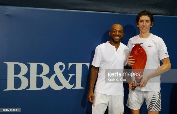 JohnPatrick Smith of Australia and Nicholas Monroe pose with the trophy after defeating Rajeev Ram and Ryan Harrison during the BBT Atlanta Open at...