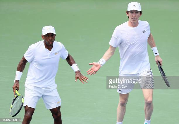 JohnPatrick Smith of Australia and Nicholas Monroe react against Christopher Eubanks and Donald Young during the BBT Atlanta Open at Atlantic Station...