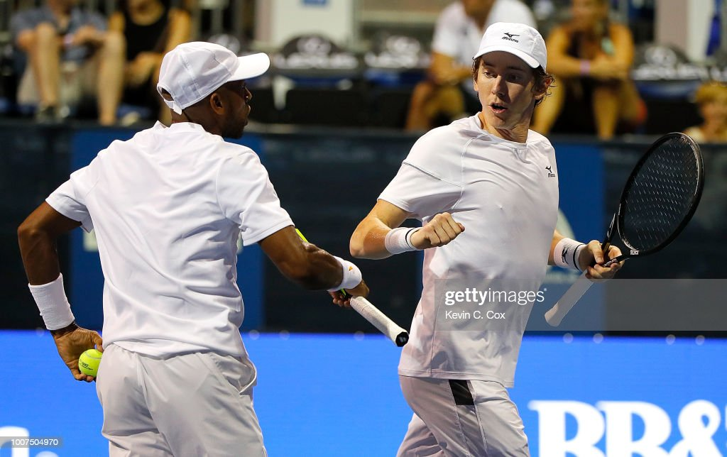 John-Patrick Smith of Australia and Nicholas Monroe react against Rajeev Ram and Ryan Harrison during the BB&T Atlanta Open at Atlantic Station on July 29, 2018 in Atlanta, Georgia.