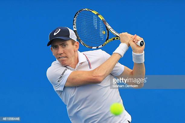 JohnPatrick Smith of Australia plays a backhand in his qualifying match against Omar Jasika of Australia for the 2015 Australian Open at Melbourne...