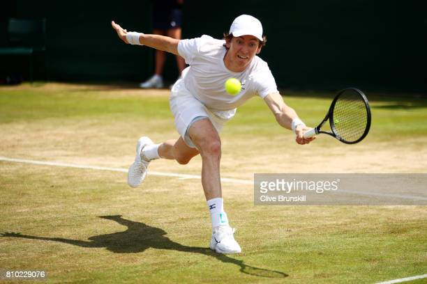 JohnPatrick Smith of Australia plays a forehand during the Gentlemen's Doubles second round match with Matt Reid of Australia against Nicholas Monroe...