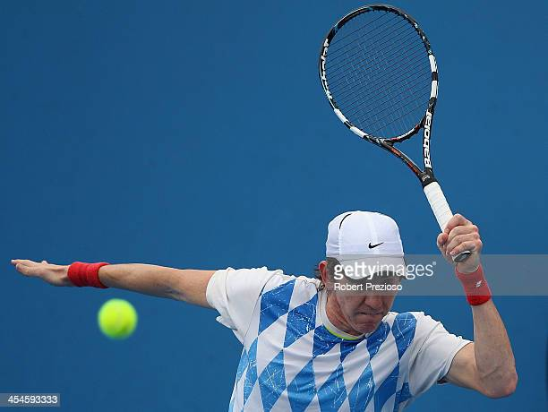 JohnPatrick Smith of Australia plays a forehand in his first round match against Marc Polmans of Australia in the Australian Open 2014 Qualifying at...