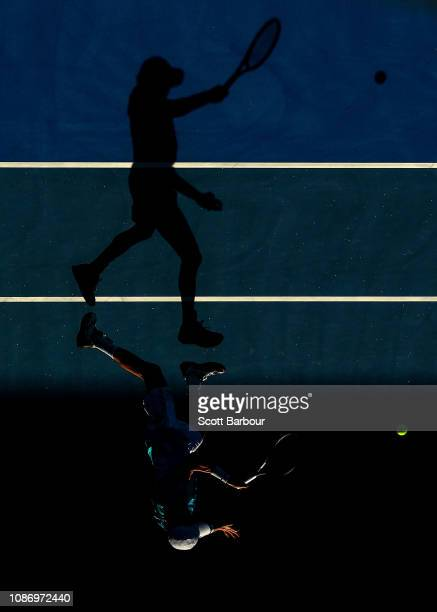 JohnPatrick Smith of Australia plays a shot in his Mixed Doubles Quarterfinals match with Astra Sharma of Australia against Bethanie MattekSands of...