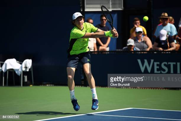 JohnPatrick Smith of Australia reacts against Jonathan Eysseric of France and Franko Skugor of Croatia during their first round Men's Doubles match...