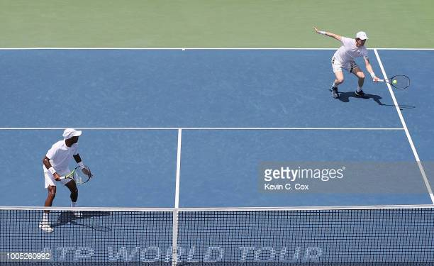 JohnPatrick Smith of Australia returns a forehand to Christopher Eubanks and Donald Young during the BBT Atlanta Open at Atlantic Station on July 25...