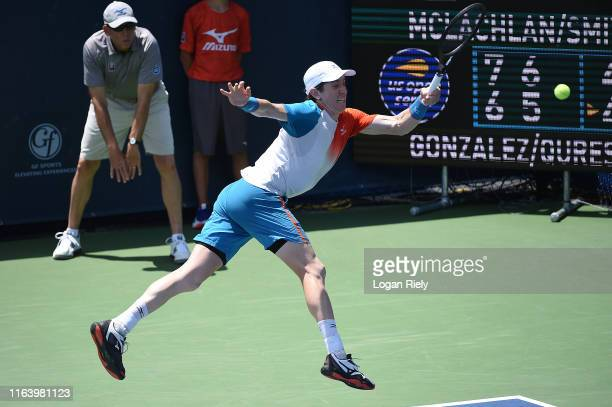 JohnPatrick Smith of Australia returns a forehand to Santiago Gonzalez of Mexico and AisamulHaq Quereshi of Pakistan during the BBT Atlanta Open at...