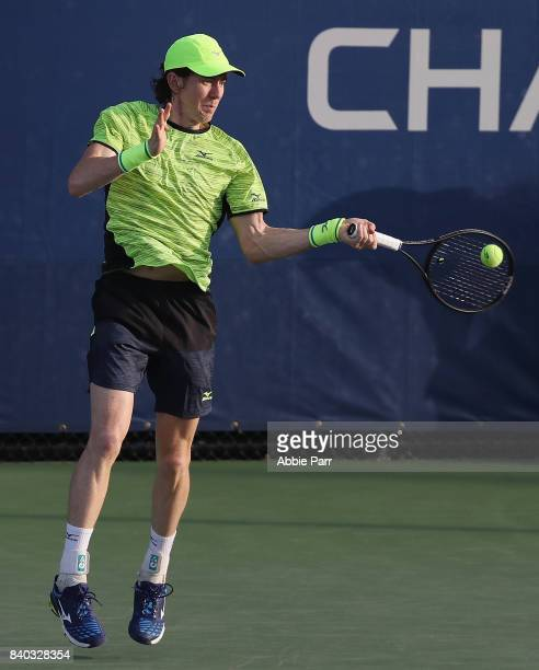JohnPatrick Smith of Australia returns a shot during his first round Men's Singles match against Thomas Fabbiano of Italy on Day One of the 2017 US...