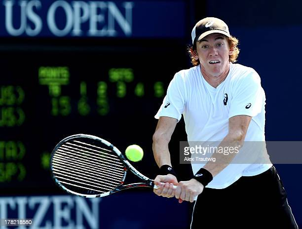 JohnPatrick Smith of Australia returns a shot next to his partner Paul Hanley of Australia during their men's doubles first round match against Fabio...