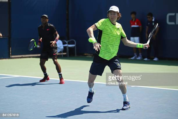 JohnPatrick Smith of Australia returns a shot with Nicholas Monroe of the United States against Jonathan Eysseric of France and Franko Skugor of...