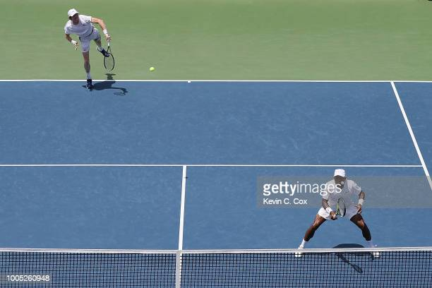 JohnPatrick Smith of Australia serves to Christopher Eubanks and Donald Young during the BBT Atlanta Open at Atlantic Station on July 25 2018 in...