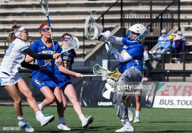 Johns Hopkins Aurora Cordingley scores past Hofstra Maddie Fields during a women's college Lacrosse game between the Johns Hopkins Blue Jays and the...