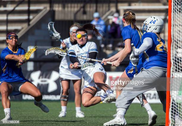 Johns Hopkins Emily Kenul fires in a shot during a women's college Lacrosse game between the Johns Hopkins Blue Jays and the Hofstra Pride on March...