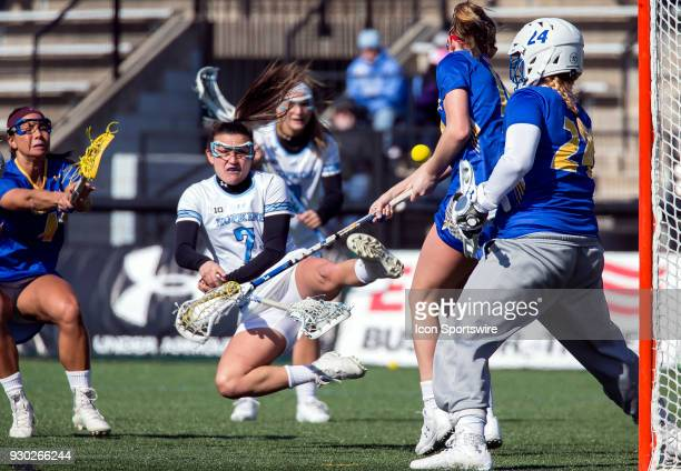 Johns Hopkins Emily Kenul fires in a shot on Hofstra Maddie Fields during a women's college Lacrosse game between the Johns Hopkins Blue Jays and the...