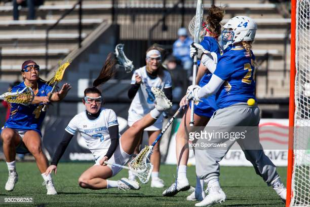 Johns Hopkins Emily Kenul scores past Hofstra Maddie Fields during a women's college Lacrosse game between the Johns Hopkins Blue Jays and the...