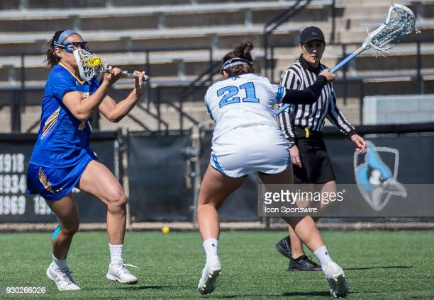 Johns Hopkins Jeanne Kachris defends against Hofstra Alyssa Parrella during a women's college Lacrosse game between the Johns Hopkins Blue Jays and...