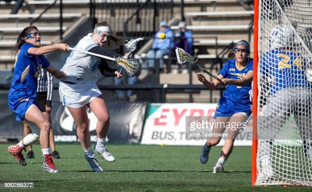 Johns Hopkins Mackenzie Heldberg slings in a fierce shot during a women's college Lacrosse game between the Johns Hopkins Blue Jays and the Hofstra...