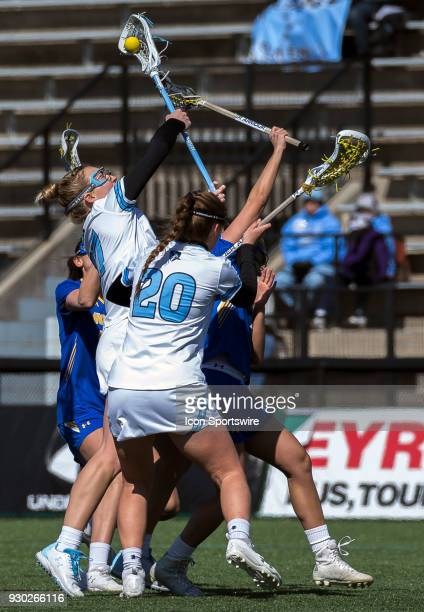 Johns Hopkins Morgayne Rix reaches p for the ball during a women's college Lacrosse game between the Johns Hopkins Blue Jays and the Hofstra Pride on...