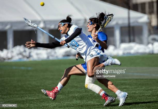 Johns Hopkins Trinity McPherson clashes with Hofstra Alexa Mattera during a women's college Lacrosse game between the Johns Hopkins Blue Jays and the...