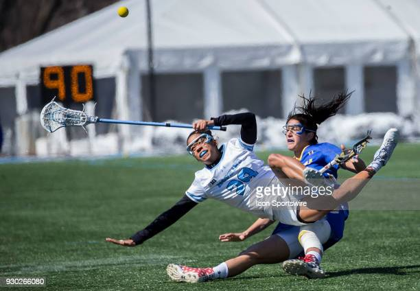Johns Hopkins Trinity McPherson collides with Hofstra Alexa Mattera during a women's college Lacrosse game between the Johns Hopkins Blue Jays and...