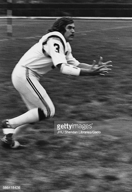 Johns Hopkins University football player Bill Nolan reaches his hands out in anticipation of a pass 1972