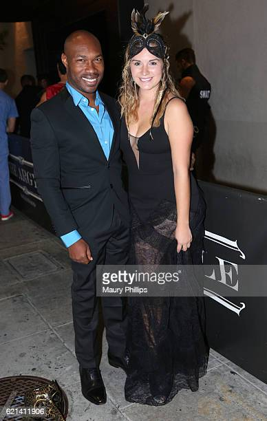 CJ Johnson and Ambar Januel attend LA Travel Magazines Le Mystique Masquerade Ball at The Argyle on October 29 2016 in Hollywood California