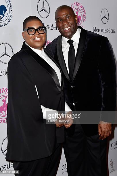 Johnson and honoree Earvin 'Magic' Johnson attend the 2014 Carousel of Hope Ball presented by MercedesBenz at The Beverly Hilton Hotel on October 11...