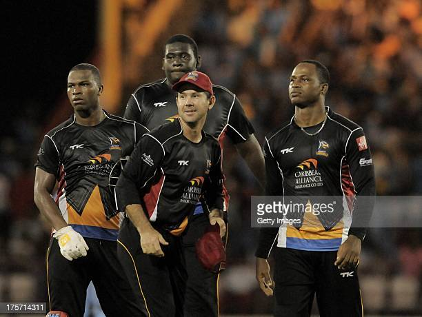 Johnson Charles Rahkeem Cornwall Ricky Ponting and Marlon Samuels of Antigua Hawksbills in celebration mode during the Eighth Match of the Caribbean...