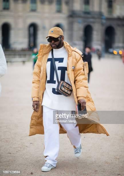 Johnson Gold is seen wearing beige Puma down feather puffer coat outside Kenzo during Paris Fashion Week Menswear F/W 20192020 Day Six on January 20...