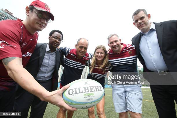 Johnson Harvey Gamu Chiwenga Stan Christian Cherie Christian Jason Conlin and Brad Emery of Kowloon Rugby Club members pose for a picture for their...