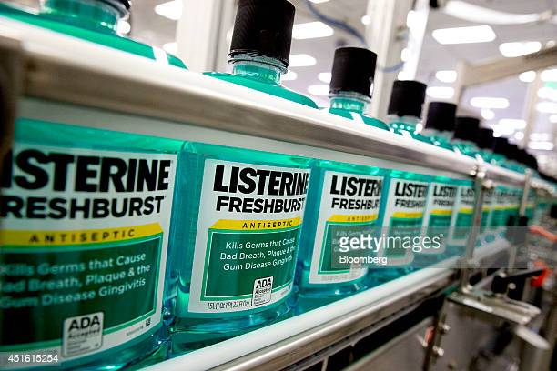 Johnson Johnson Listerine brand freshburst mouthwash bottles move through the production line on a conveyor at the JJ consumer healthcare products...