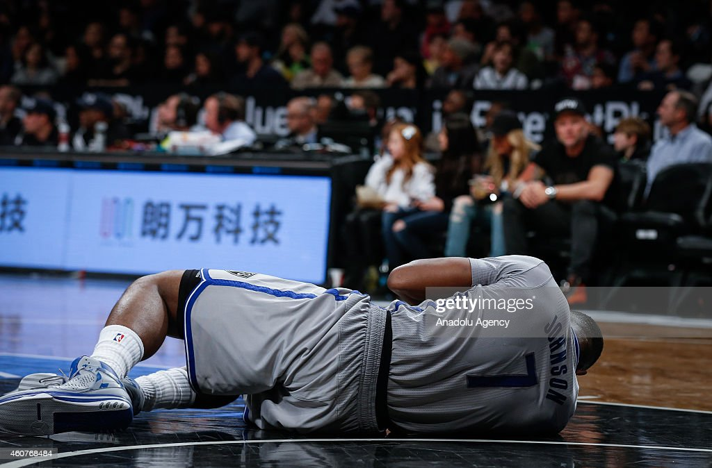 Johnson #7 of Brooklyn Nets lies on the ground after being injured during NBA basketball game between Brooklyn Nets and Detroit Pistons at the Barclays Center in the Brooklyn Borough of New York City, on December 21, 2014.