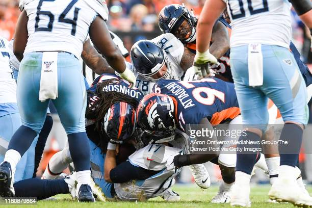 Johnson of the Denver Broncos and Jeremiah Attaochu sack Ryan Tannehill of the Tennessee Titans during the fourth quarter of Denver's 16-0 win on...