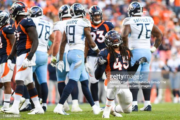 Johnson of the Denver Broncos celebrates his sack on Ryan Tannehill of the Tennessee Titans during the fourth quarter of Denver's 16-0 win on Sunday,...