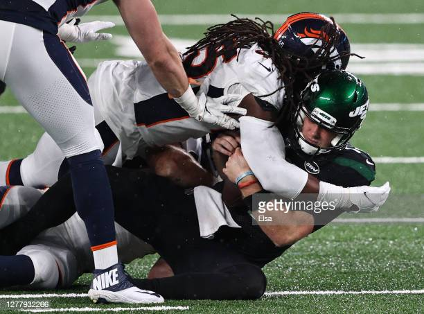 Johnson of the Denver Broncos sacks Sam Darnold of the New York Jets during the third quarter at MetLife Stadium on October 01, 2020 in East...