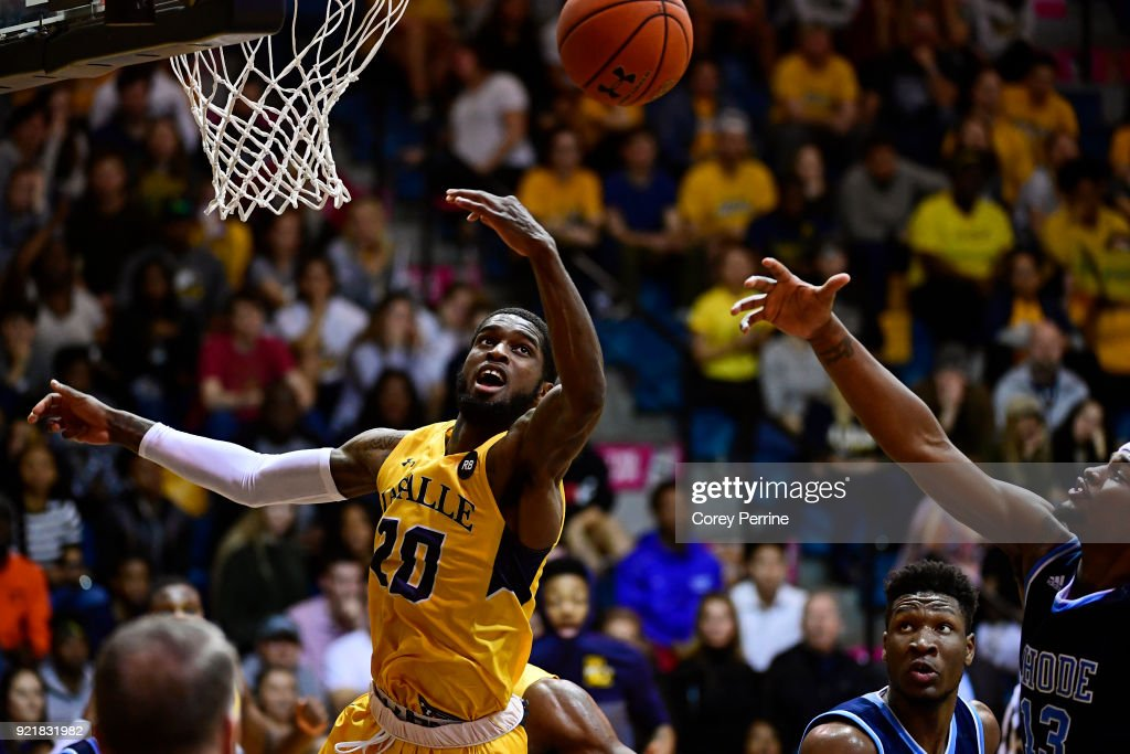 B.J. Johnson #20 of the La Salle Explorers and Stanford Robinson #13 of the Rhode Island Rams vie for the ball during the second half at Tom Gola Arena on February 20, 2018 in Philadelphia, Pennsylvania. Rhode Island edged La Salle 95-93 in overtime.