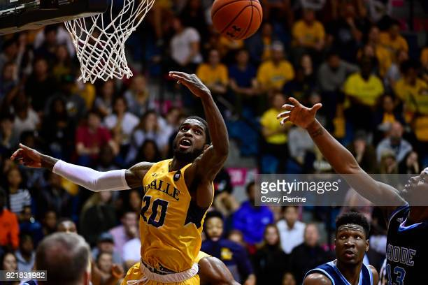 J Johnson of the La Salle Explorers and Stanford Robinson of the Rhode Island Rams vie for the ball during the second half at Tom Gola Arena on...