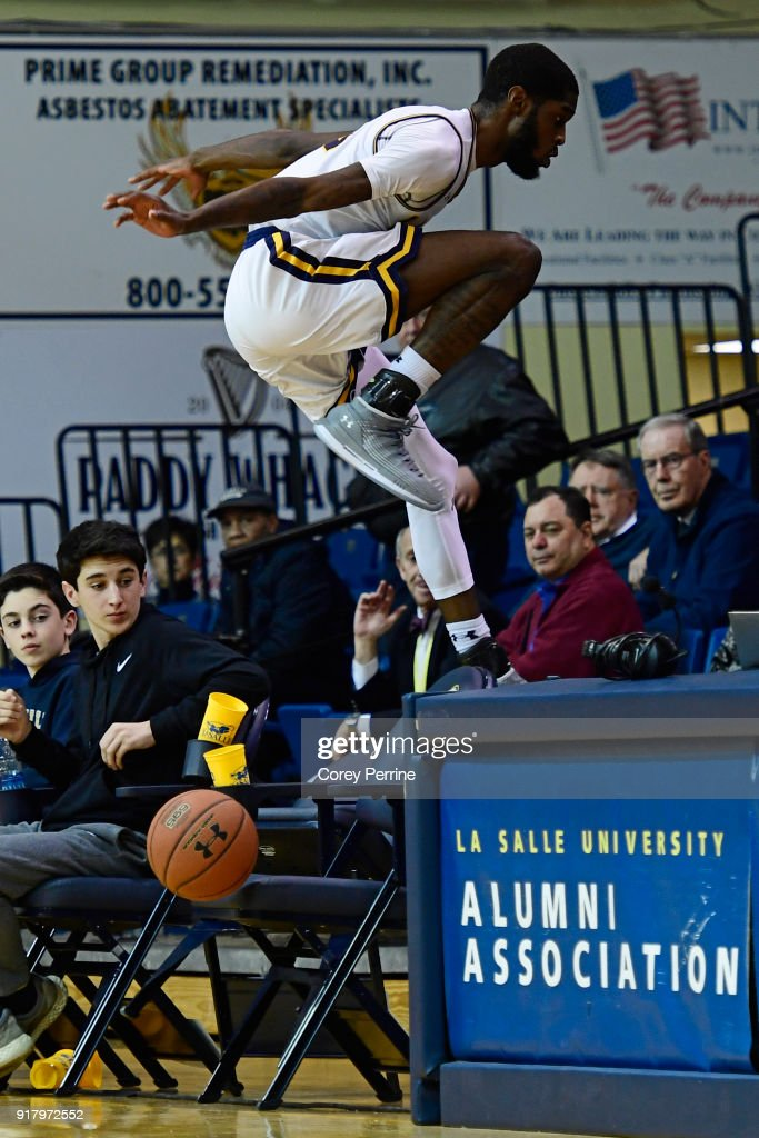 B.J. Johnson #20 of the La Salle Explorers avoids collision with empty chairs against the St. Bonaventure Bonnies during the second half at Tom Gola Arena on February 13, 2018 in Philadelphia, Pennsylvania. St. Bonaventure defeated La Salle 79-68.