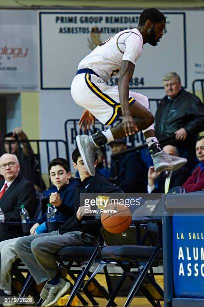 BJ Johnson of the La Salle Explorers avoids collision with empty chairs against the St Bonaventure Bonnies during the second half at Tom Gola Arena...