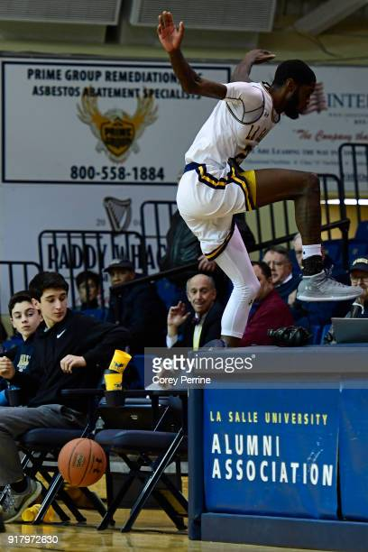 J Johnson of the La Salle Explorers avoids collision with empty chairs against the St Bonaventure Bonnies during the second half at Tom Gola Arena on...