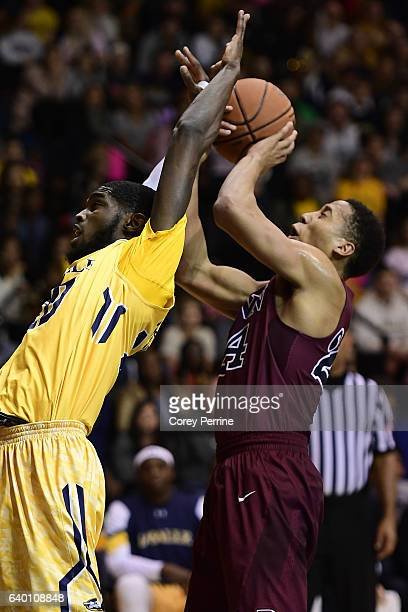J Johnson of the La Salle Explorers can't contain the ball as Matt Howard of the Pennsylvania Quakers takes advantage during the second half at Tom...
