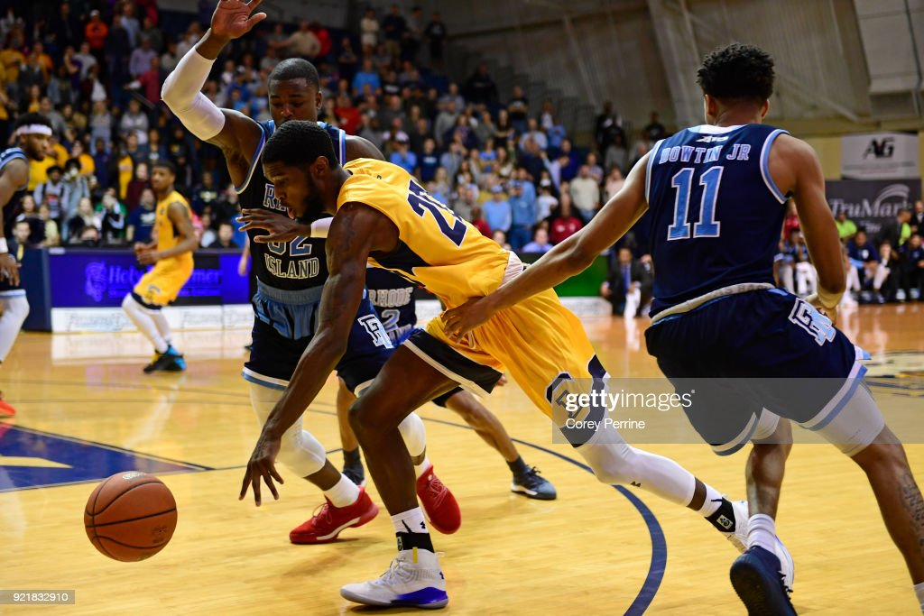 B.J. Johnson #20 of the La Salle Explorers dribbles past Jared Terrell #32 of the Rhode Island Rams during overtime at Tom Gola Arena on February 20, 2018 in Philadelphia, Pennsylvania. Rhode Island edged La Salle 95-93 in overtime.