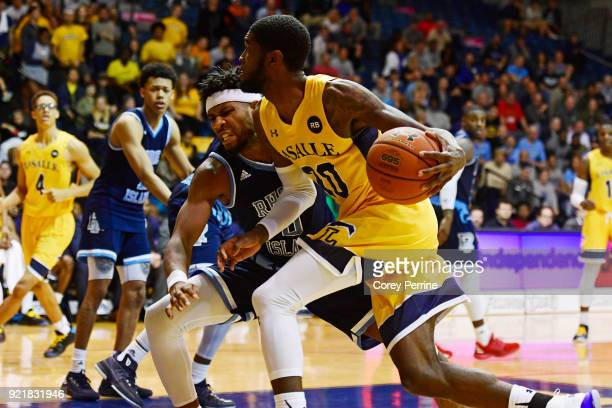 J Johnson of the La Salle Explorers drives to the basket against EC Matthews of the Rhode Island Rams during overtime at Tom Gola Arena on February...