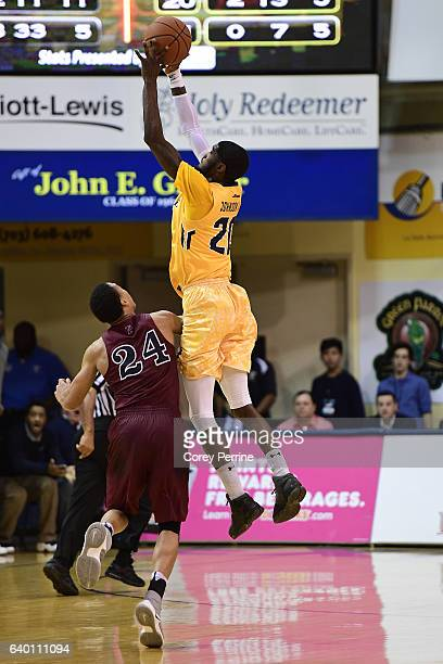J Johnson of the La Salle Explorers intercepts a pass against Matt Howard of the Pennsylvania Quakers during the second half at Tom Gola Arena on...